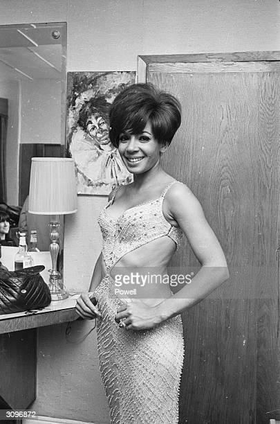 Welsh singer Shirley Bassey wearing the daring cutaway dress that was banned on American television
