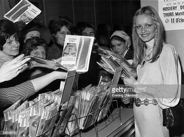 British model and sixties icon Twiggy selling her own brand of tights at Selfridges department store in London.