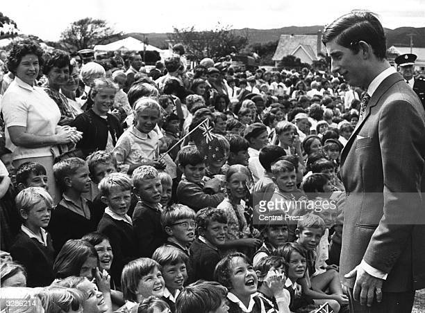 Charles Prince of Wales being greeted by a crowd of children during a Royal visit to New Zealand