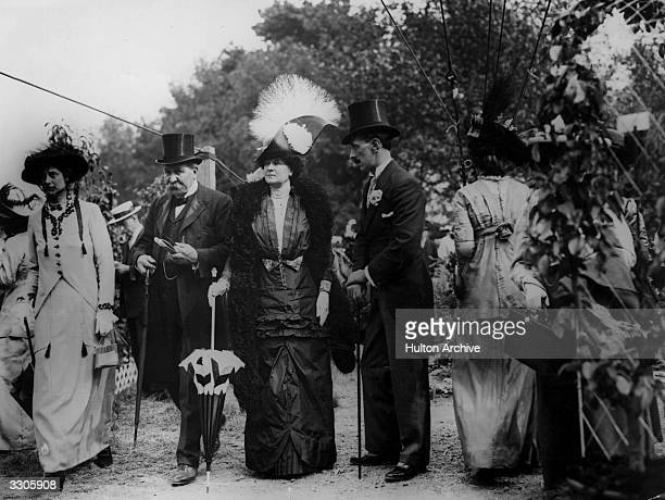 Lady Abbott Anderson at the Chelsea Flower Show, wearing a high, fearthered hat.