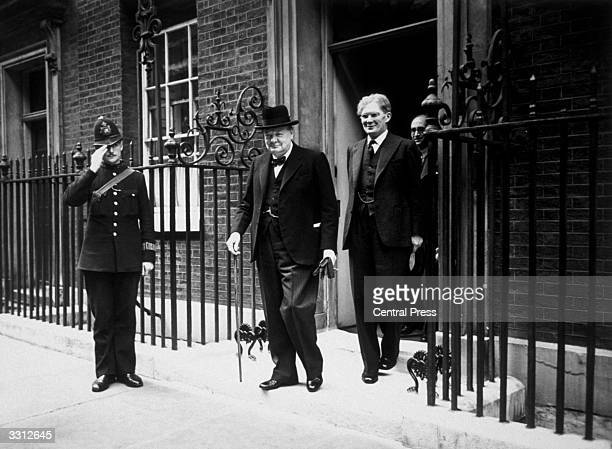 British Prime Minister Winston Churchill leaves 10 Downing Street with Irish journalist and Minister for Information Brendan Bracken