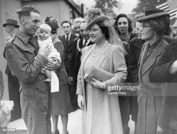 Queen Elizabeth Queen Consort to King George VI talking to a Home Guard during a visit to Camberwell South London