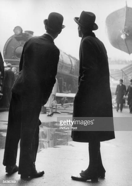 Dignitaries of St Paul's Church look at an engine on display in the Transport Pavilion on the day that the King officially opens the Festival of...
