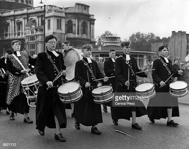 Playing drums boys from Christ's Hospital public school march away from St Paul's Cathedral London after the service to mark the 400th anniversary of...