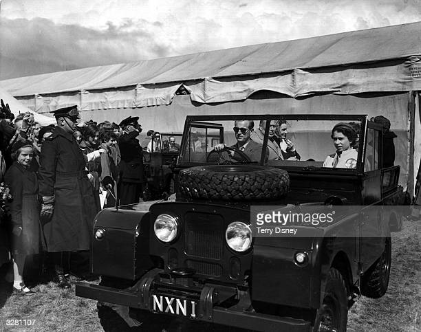 The Duke of Edinburgh at the wheel of a Land Rover sets off for a tour of the course of the European Horse Trials at Windsor with The Queen and...