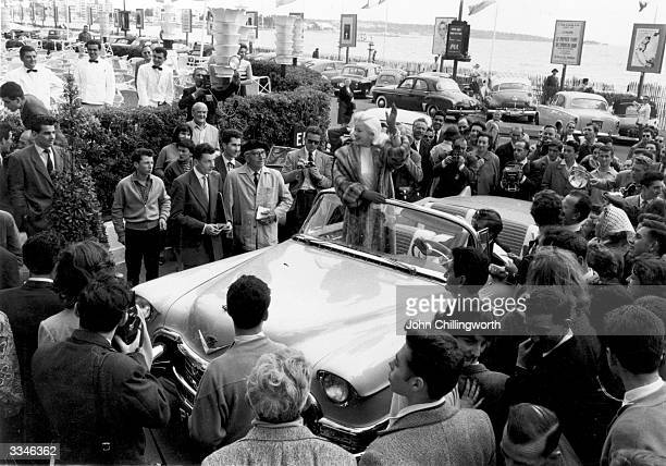 British blonde 'bombshell' actress Diana Dors formerly Diana Fluck in a light blue cadillac at the Cannes Film Festival to promote her latest film...