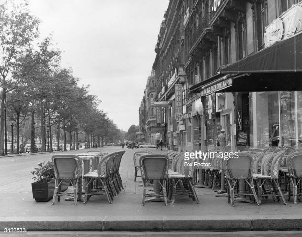 The ChampsElysees in Paris with tables and chairs on the pavement outside a cafe The streets are deserted as Paris awaits the results of a conference...