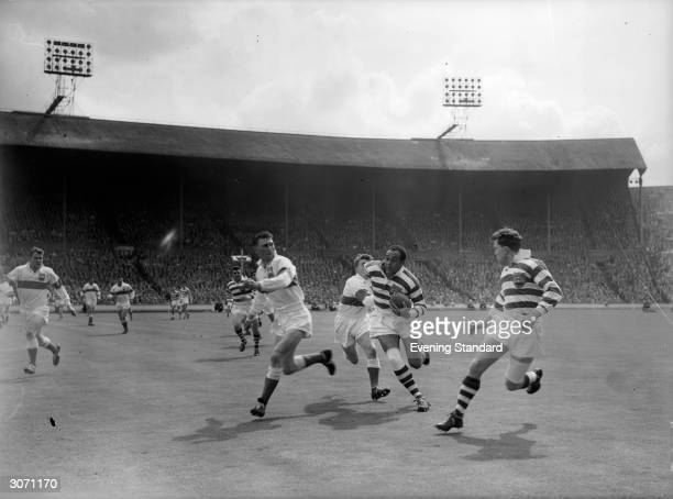 Wigan rugby team play in a match against Workington Town