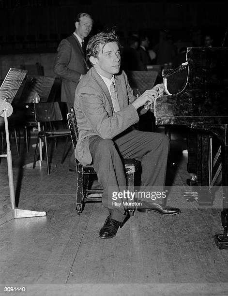 Canadian pianist, composer and writer Glenn Gould during rehearsals at the Royal Festival Hall, London. He uses a piano stool a few inches from the...