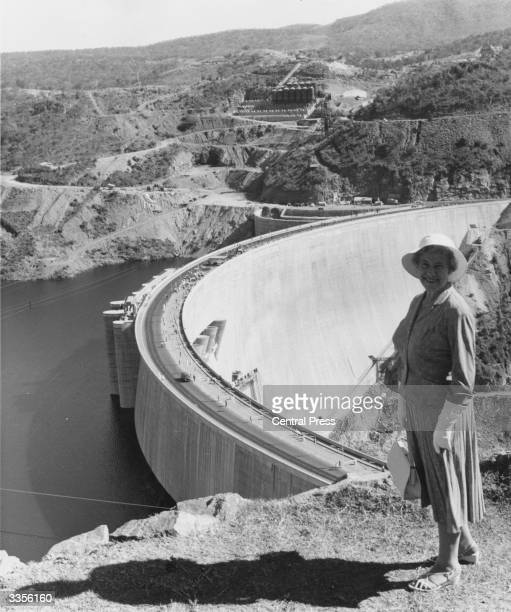 A secretary working on Kariba dam project standing by the hydro electric dam on the River Zambesi in Mozambique The retaining wall is 420 feet high...