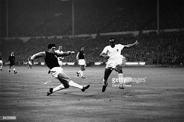 West Ham player Alan Sealey scores the first of his two goals in the final of the European Cup Winners Cup at Wembley, when West Ham beat Munich 2-0.