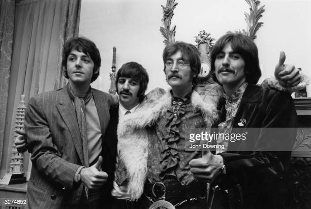 British pop group The Beatles left to right Paul McCartney Ringo Starr John Lennon George Harrison at manager Brian Epstein's west London home for a...