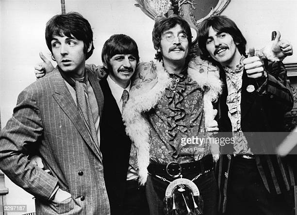 The Beatles celebrate the completion of their new album 'Sgt Pepper's Lonely Hearts Club Band' at a press conference held at the west London home of...