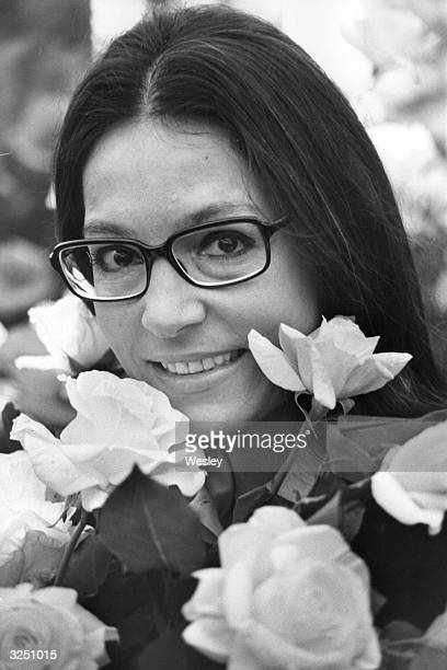 Nana Mouskouri the popular Greek singer at the Chelsea flower show with the white floribunda rose that was named after her by the Irish rose grower...
