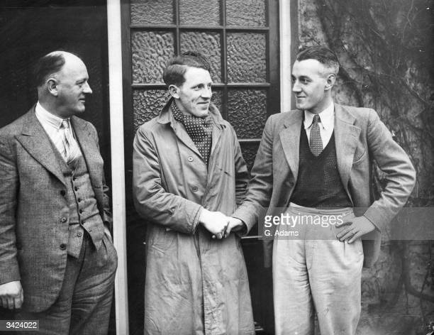 Cecil Allen the Irish International being greeted by Bambrick a fellow Irish International on his arrival at Stamford Bridge after signing for...