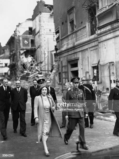 King George VI and Queen Elizabeth visit the site of a bombed London cinema in West London during a tour of the area