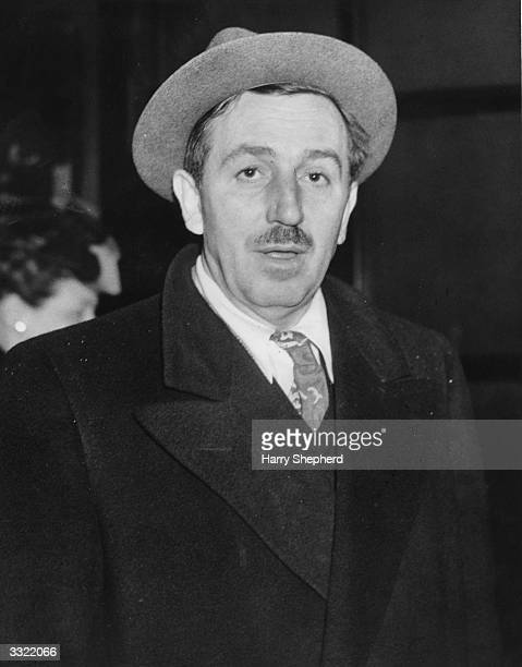 Cartoonist and film producer Walt Disney arriving in the foyer of a London hotel He is on his way to Ireland where he intends to make a film about...
