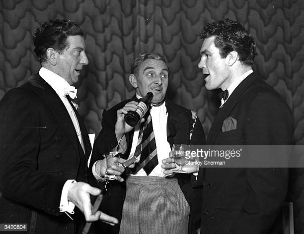 British comedians Sid Field Teddy Knox and the boxer Freddie Mills at the annual dinner of the Vaudeville Golfing Society at the Savoy Hotel in London