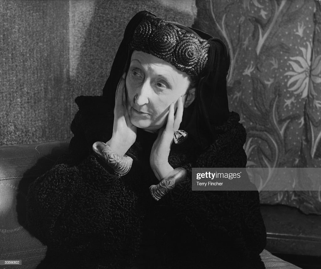 British poet and author Edith Sitwell (1887 - 1964) at a press conference in Claridges Hotel, London. She is wearing tudor style clothes that she designed herself.
