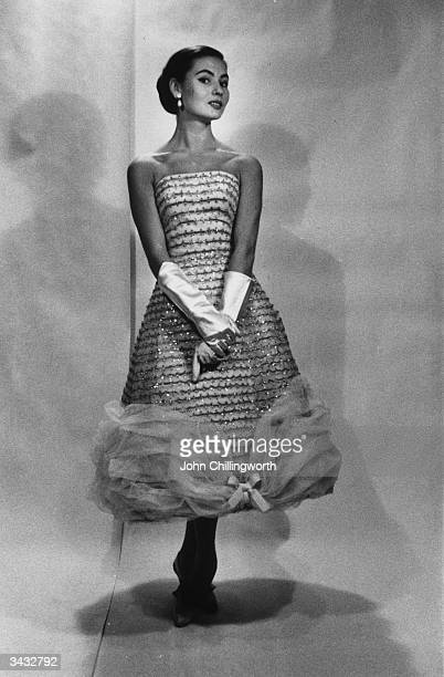 A model wearing a dress designed by Count Hubert de Givenchy at the fashion house near the Parc Monceau in Paris Original Publication Picture Post...