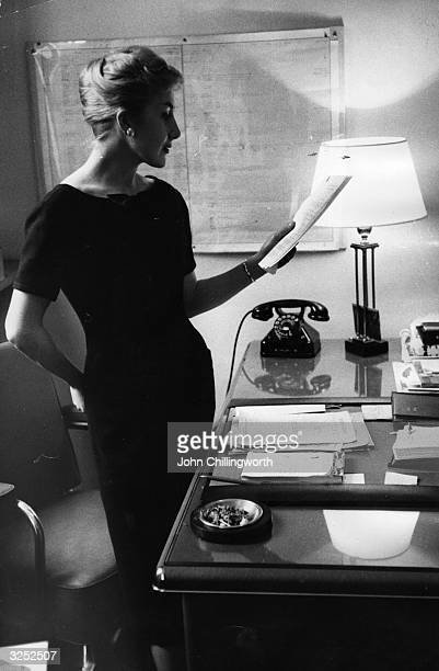 A model wearing one of the designs of Count Hubert James Marcel Taffin de Givenchy in his fashion house near the Parc Monceau Original Publication...