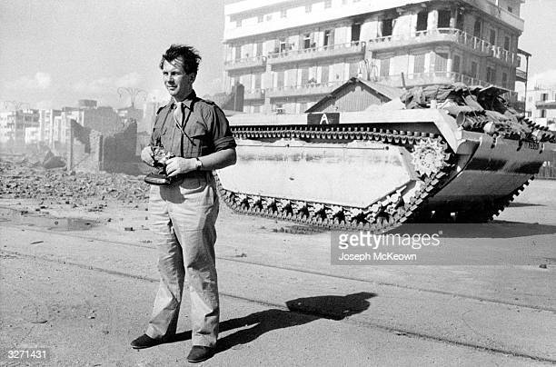 Picture Post photographer Joseph McKeown surveys with his own eyes the devastation at Port Said after the fighting during the Suez crisis LVT...