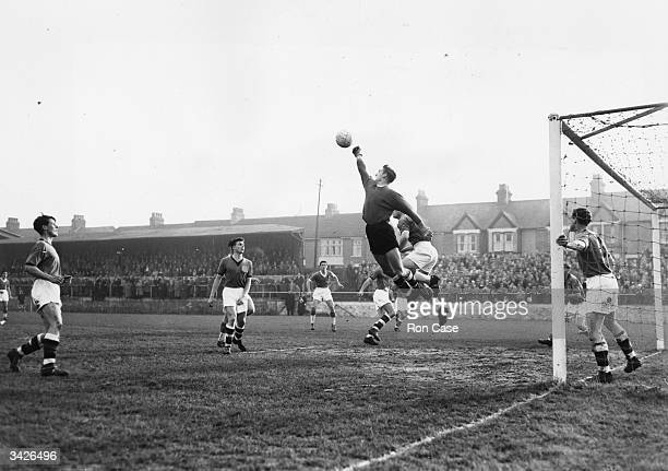 Plymouth Argyle goalkeeper Barnsley punches the ball clear from a Gillingham corner kick at Gillingham in a first round FA Cup replay