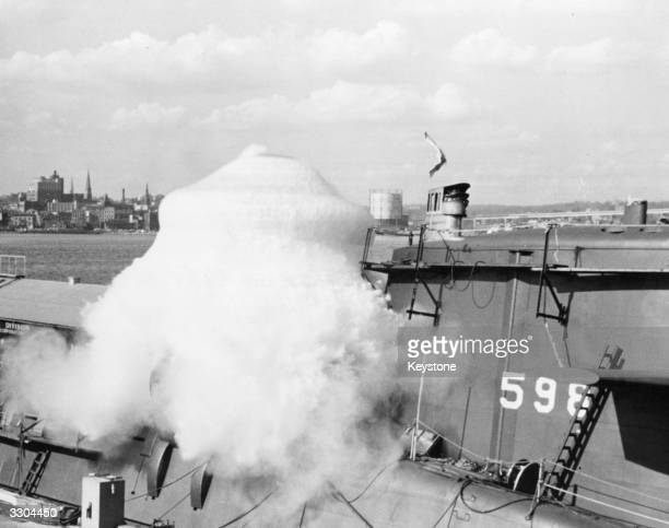A view of a plume of water erupting from a launch of a 'Sabot' round fired from a flooded Polaris Missile launch tube on the submarine USS George...