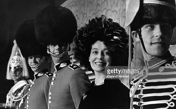 Valerie Profumo, wife of War Minister John Profumo, with some soldiers.
