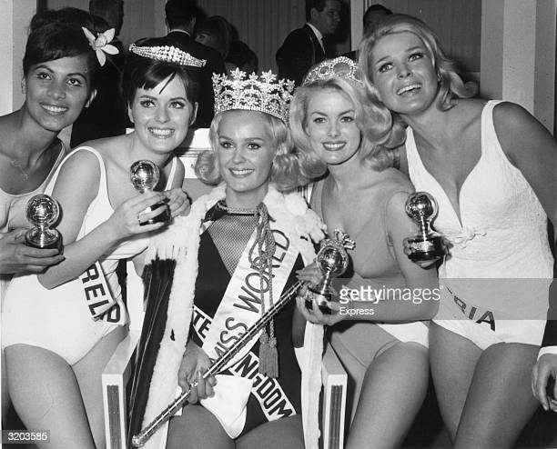 Winners of the Miss World Beauty Pageant pose together after receiving their awards in the Lyceum Ballroom London From left to right they are Marie...