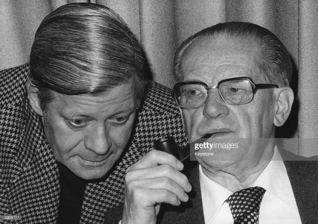 From left to right, Federal Chancellor Helmut Schmidt, and the parliamentary leader of the Social Democratic Party (SPD), Herbert Wehner, discuss matters at a SPD Party Rally in Hamburg.