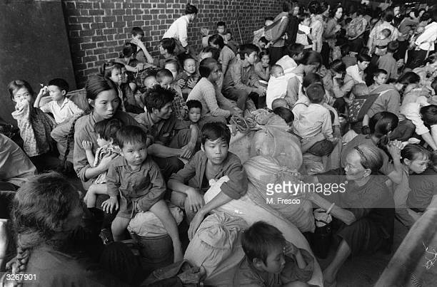 Vietnamese boat people wait in a government dockyard in Hong Kong.