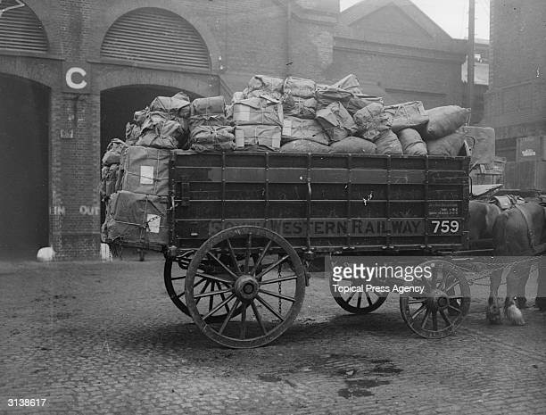 Parcels piled high in a South Western Railway's horsedrawn wagon ready for delivery from Nine Elms goods yard London