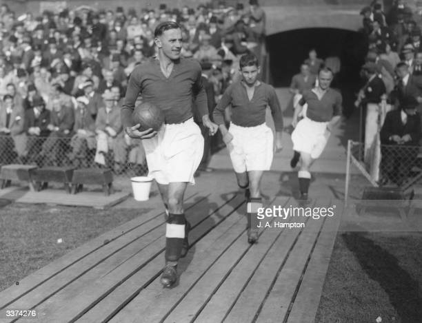 Symon captain of Portsmouth FC leading his team on to the football pitch