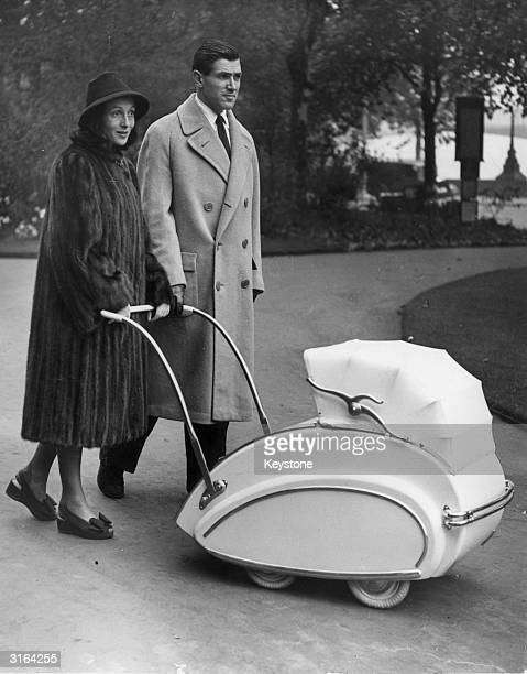 Austrianborn actress Luise Rainer and her husband Robert Knittel taking their five month old daughter for a walk in an unusual streamlined pram on...
