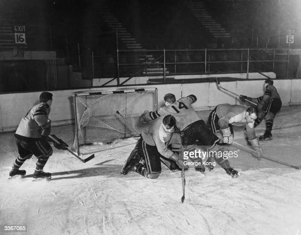 Earl's Court Rangers ice hockey team practicing in front of the goal Left to right Gagnon Green checking Rissi Caduc and Dunville