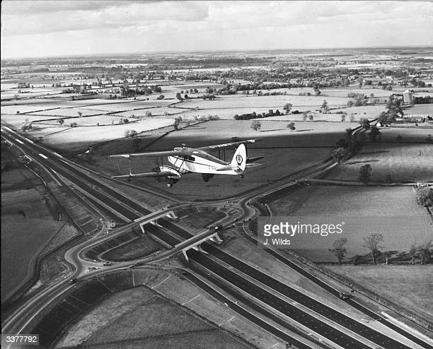 A spotter aircraft over the Broughton flyover near Newport Pagnell on the new London to Birmingham motorway which opens shortly The stretch of road...