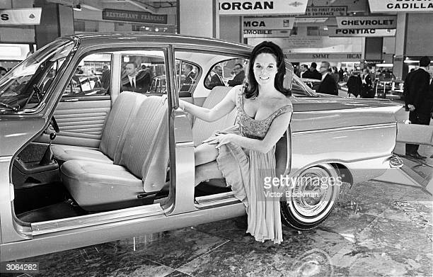 Model and actress Gina Warwick sitting in a Humber Sceptre at the 1965 motor show at Earl's Court