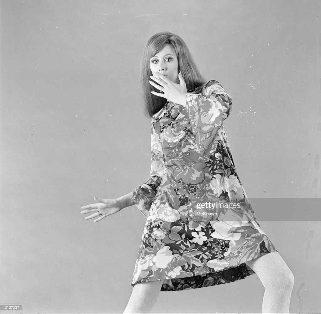 A woman modelling a floral patterned dress on banlon jersey, designed by Ken Scott.