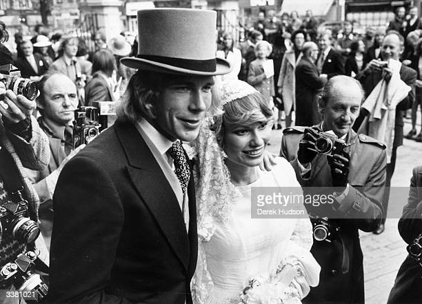English motorracing champion James Hunt and his bride Suzy Miller on their wedding day outside Brompton Oratory London