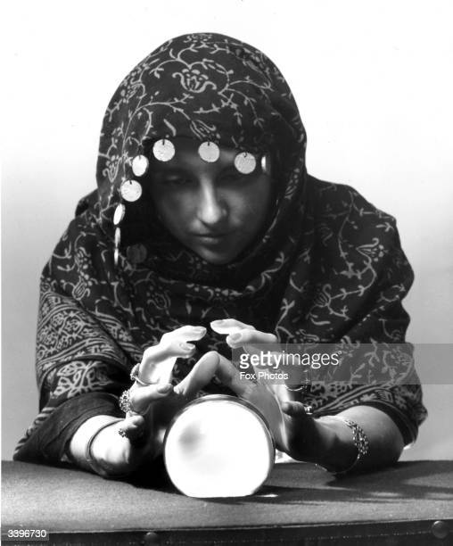 A fortune teller looking into her crystal ball