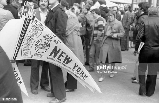 New York A vendor sells Yankees World Series banners at a ticker tape parade on Broadway's Canyon Of Heroes