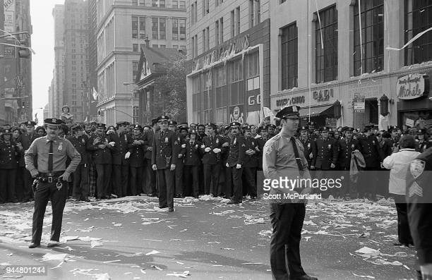 New York Dozens of police officers from the NYPD line Broadway's Canyon Of Heroes and hold fans back during a ticker tape parade The parade is...