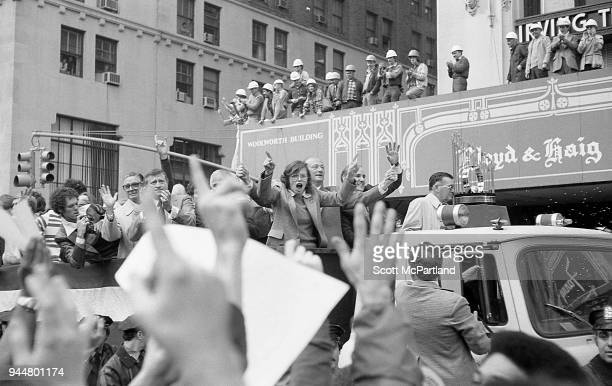 New York Fans cheer as George Steinbrenner and other New York Yankees team members ride down Broadway's Canyon Of Heroes during a ticker tape parade...