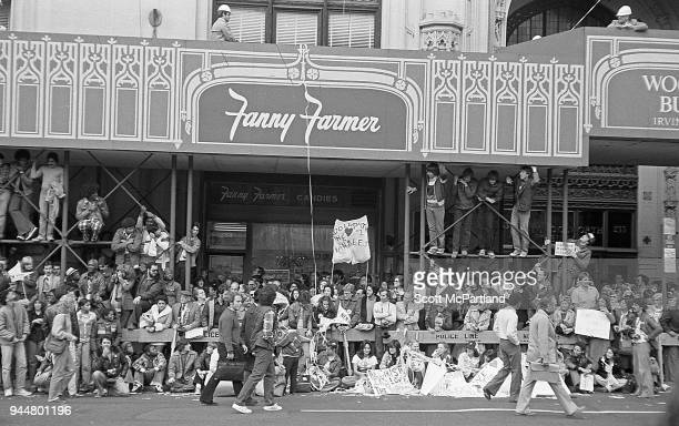New York Hundreds of Yankees fans line up outside a department store on Broadway during a ticker tape parade The parade is celebrating the Yankees...