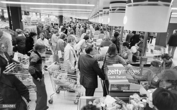 Shoppers at the checkout of a Sava Centre supermarket