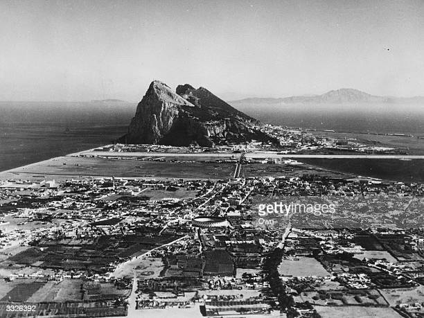 The Rock of Gibraltar with the Spanish town of La Linea in the foreground and North Africa's Atlas Mountains in the background