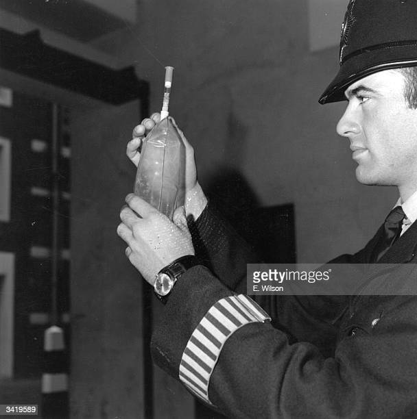 A policeman checking the crystal reading of one of the newly introduced breathalyser tests