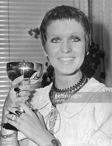Singer Julie Driscoll 'Jools' with the cup she received after being voted Britain's top woman vocalist by readers of the Melody Maker