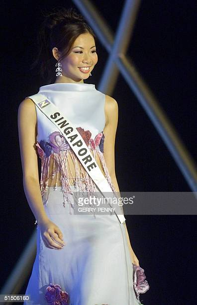 19yearold Charlyn Ding of Singapore poses on stage during the Miss World final at the Millenium Dome in London 30 November 2000